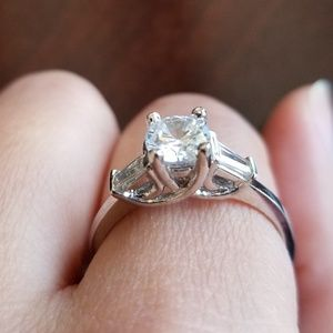 Jewelry - 925 sterling silver ring with cubic z's. Size 9